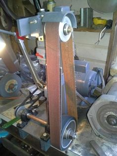 Belt Sander by gtermini -- Homemade belt sander constructed from steel plate, an electric motor, pillow bearings, contact wheels, nuts, and bolts. http://www.homemadetools.net/homemade-belt-sander-33
