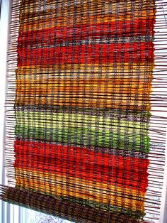 Window shade woven with cotton warp, fabric strips and native prairie grasses