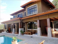 """""""Villa Aurelia"""" luxury Ocean View villa with private swimming pool is a 3 bedroom, bath vacation property located in Playa Hermosa Beautiful Villas, Beautiful Homes, Ocean View Villas, Beach Chairs, Private Pool, Ideal Home, Swimming Pools, Costa Rica, House Styles"""