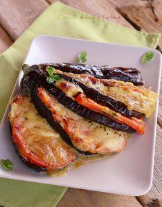Melanzane con pomodoro e mozzarella ricetta vegetariana