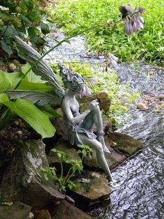 Fairy statue in running stream/water garden(Diana's)