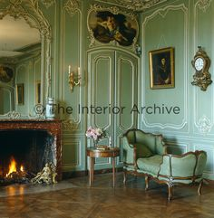 Montmirail ~ The ornate green painted boiserie in the salon is complimented by a painted panel above each door representing each of the five senses and attributed to the School of Boucher.