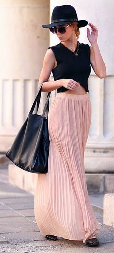 pleated long maxi skirt with top black cutout blouse, black leather hand bag , black shoes and cute black hat