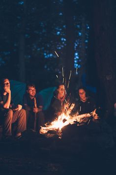 Group of People Sitting Near Bonfire