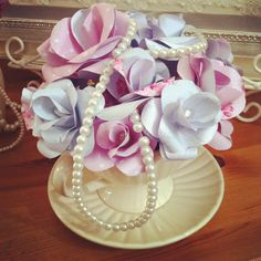 pretty tea cup with handmade paper flowers