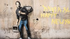 "The photo shows new work by elusive British artist Banksy, at the refugee camp known as the ""Jungle"" in Calais, in northern France. This one, painted on a concrete bridge, depicts the late Steve Jobs, co-founder and CEO of Apple."