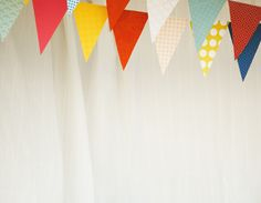 DECORATIONS: Paper Bunting. Paper Source papers and twine used.  Photography by Jaime Windon the Blonde Photographer (2010). (http://theblondephotographer.com) Creative: Chris Norman, Alex Cummings & Lusine Sargsyan (2010)