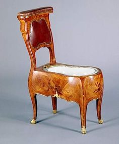 Bidet with lid removed, France, 3rd quarter 18th Century, Louis XV's residence Bellevue. Built in walnut, rosewood veneer, marquetry floral violet wood, gilt bronze, lead, with ceramic inset.