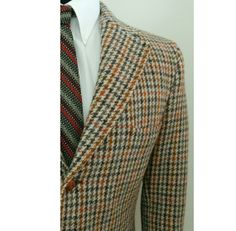 Vintage 1960s early 1970s Harris Tweed jacket from Dunn & Co. Made in Great Britain.