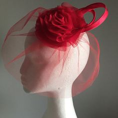 New in the shop today, a red veil flower headpiece, birdcage style, in a glamorous red shade. Rock on the vintage glam look!