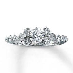 Round Diamond Engagement Ring with cluster of diamonds surrounding.