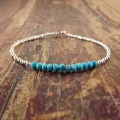 Turquoise Bracelet with Karen Hill Tribe Silver Beads. $42.00, via Etsy.