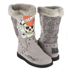 Warm faux fur lined suede boots brought to you by Ed Hardy and designer Christian Audigier. The Boot Strap Boots feature tattoo designs in front and back with eagle and rose motif. Suede strap with buckle closure around ankle feature metal buckle and emblems. Metal grommets line each seam for that extra dose of rock n' roll glamour. Flat and flexible sole for added comfort. Don Ed Hardy Designs pa ...
