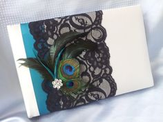 Ivory Peacock Feather Teal Guest Book. Ivory Peacock Feather Teal Guest Book on Tradesy Weddings (formerly Recycled Bride), the world's largest wedding marketplace. Price $23.00...Could You Get it For Less? Click Now to Find Out!