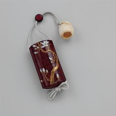 Inrō are small containers with multiple chambers for holding medicinal herbs, seals, and other small items. They are worn suspended from a sash by means of small toggles that are known as netsuke. Use of inrō, which developed in lieu of pockets in traditional Japanese clothing, flourished from the seventeenth to the nineteenth century