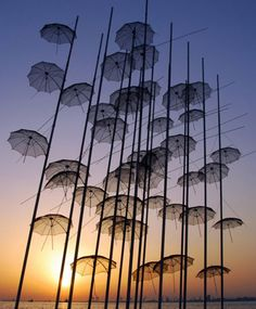 "George Zongolopoulos: ""Umbrellas"",1997, heigh: 13,00m, stainless metal, on the seafront of the city of Thessaloniki, Greece         http://www.zongolopoulos.gr/"