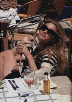 I want to be her, sitting across from Ben, in a piazza, in Sicily, on the Mediterranean