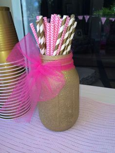 Gold mason jar and striped straws at a Pink & Gold Birthday Party!  See more party planning ideas at CatchMyParty.com!
