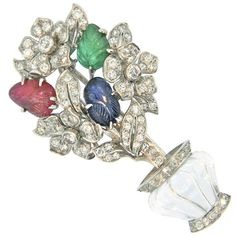 1920s Carved Multi Gem Diamond Platinum Tutti Frutti Flower Basket. A gorgeous, late 1920's, French Art Deco, Carved Rock crystal, Carved Sapphire, Carved Ruby, and Diamond Tutti Frutti Flower Basket Brooch.