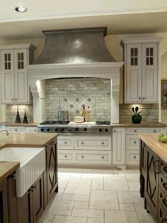 Two Colored Cabinets And Travertine Flooring. Beautiful Kitchens!