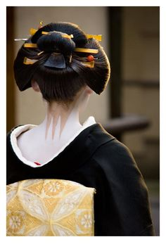 Coquette. notice the geisha neck paint/makeup. The neck is left uncovered because it is considered to be one of the most erotic regions on a woman's body.