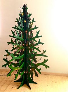 Recycled cardboard christmas tree painted green - so yes this year!  #green #cardboard #christmas #tree