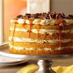 Pumpkin Torte Recipe -This beautiful layered cake has a creamy filling with a mild pumpkin flavor and a little spice. It's quick and always turns out so well. The nuts and caramel topping add a nice finishing touch. —Trixie Fisher, Piqua, Ohio