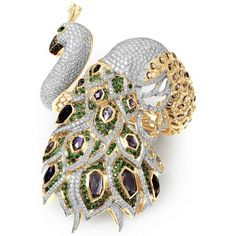 A sensational @farahkhanfinejewellery yellow gold hand cuff with iolites, tsavorite garnets, white and brown diamonds