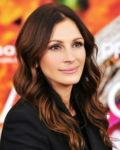 Mahogany brown hair - Adding some warm, copper and red tones to dark brown hair can generate the perfect bit of contrast and dimension to an otherwise flat and drab brown.