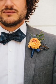 yellow + blue boutonniere, photo by Sweet Little Photographs http://ruffledblog.com/modern-palm-springs-wedding #boutonnieres #grooms