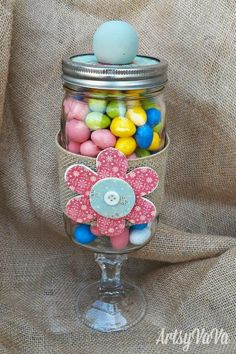Cute mason jar candy jar - kind of like an apothecary jar. Just glue the burlap to the jar and wood flower to the burlap (cover with scrapbook paper), put wooden knob on top, glue dollar store glass candlestick holder to bottom, add candy and Voila!