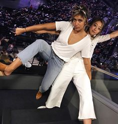 Serena Goh of The Spicy Stiletto in the Sammie Wide Leg Crop at the Florence + the Machine concert with BFF Christina Cardona of Troprouge