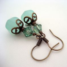 Lovely synthetic Aqua Chalcedony pumpkin beads are adorned with antiqued brass filigree and topped with Erinite Swarovski crystals. Swing from antiqued brass ear wires. Measures 1 1/2 inches in length from top of ear wire to bottom of bead. These will be quickly made to order and promptly shipped.
