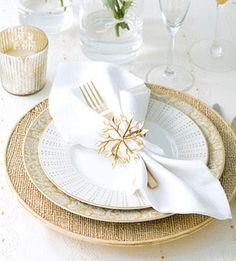 Golden Table Setting: Pull the basics from your china hutch -- white linens, champagne flutes, and your best china -- to create this elegant look. A floral plate and a leafy napkin ring look right for the holidays and year-round. Festive Christmas Table P Table Place Settings, Christmas Table Settings, Christmas Tablescapes, Christmas Table Decorations, Wedding Table Settings, Holiday Tables, Wedding Decorations, Elegant Christmas, Gold Christmas