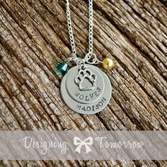 Want!  This would be a very good gift idea lol.  No beads.  Dakota on top, Nahla bottom.  Personalized Wolves or Paw Print Necklace by Designing Tomorrow, $30.00