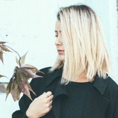 blonde chop with slight dark roots.