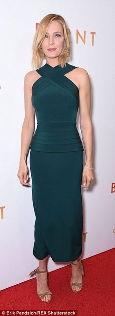 Green with envy: Uma, 45, cut an almost otherworldy figure in her tight teal dress on the ...