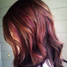 chestnut brown with caramel and subtle reddish-plum highlights