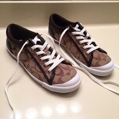 NEW [Coach] sneakers women's size 8.5 Brand new, never worn Coach sneakers. Adorable, mocha colored unique design :) Women's size 8.5. Same day shipping!! $50 on Mercari!! Buy 3 or more items from my closet to get my seller discount added to your order at checkout! ☺️ Coach Shoes Sneakers