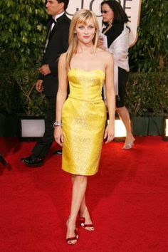 Reese makes an entrance in a vibrant yellow Nina Ricci dress