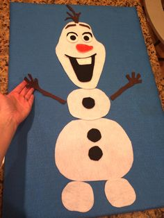 "Our ""build an Olaf"" made out of felt (glued felt to cardboard, hand-cut pieces, disassemble and reassemble - just like Olaf!"
