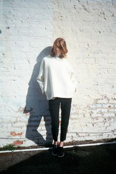 white jumper and black pants