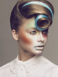 Fashion Photo by Igor Oussenko- use a colorful hair extension to create pin curl for style dimension