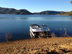 Calibre & PD parked on a bank in Italian bay, #lakeeildon #houseboats
