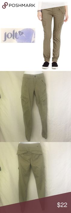 Jolt Elastic-Cuff Soft Cargo Pants - Olive Green Cargo meets couture with these machine washable, stylish, comfortable, yet rugged styled pants. These great cargo pants feature zippered flush pockets, a button front closure and zipper fly, and, most fashionably, elastic cuffed ankles. These cuties are sure to be a hit for anyone! Jolt Pants Track Pants & Joggers