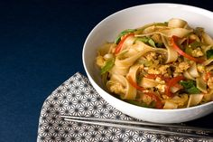 Pad Kee Mao (Spicy Ground Chicken and Rice Noodles): rice noodles, oyster sauce, fish sauce, lime juice, vegetable oil, shallots, garlic, ground chicken, red or green bell peppers, eggs, jalapeños, Thai basil