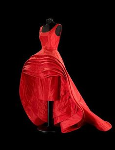 1956 - Roberto Capucci red silk taffeta skirt nine layers.  Capucci was inspired by the concentric circles produced when a stone is thrown into the water