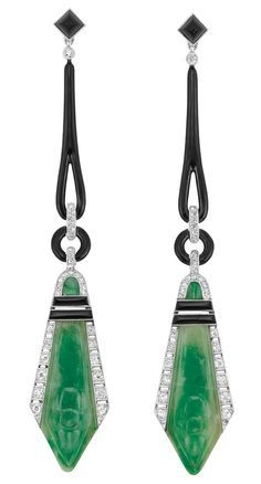 Pair of Art Deco Platinum Black Onyx Black Enamel Diamond and Carved Jade Pendant-Earrings France. Topped by 2 square-shaped sugarloaf cabochon black onyx joined by tapered black enamel loops and black enamel circles flanked by diamond-set bands suspending 2 fancy-shaped carved jade plaques with French assay marks circa 1920.