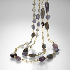 "This Rosanne Pugliese necklace is flirty, feminine and fiercely gorgeous! Handcrafted from 22K yellow gold, the hand-wrapped wire holds labradorite, iolite, spinel and moonstone beads. The earthy colors and delicate details are what makes this layering piece so special.Total length measures 30.5""."