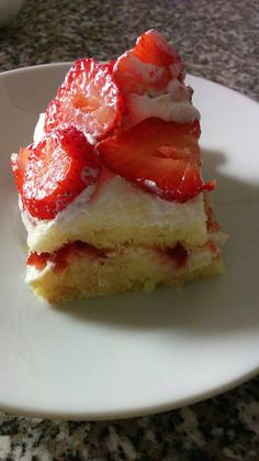 Gluten free sponge cake, with soy whipped cream and strawberries.